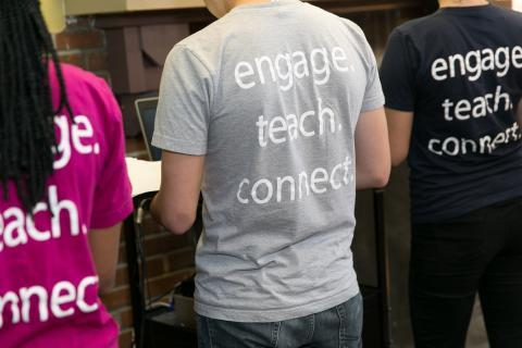 Student with t-shirt with the slogan: engage, teach, connect